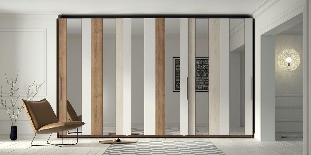Armarios de puertas correderas con los frentes m s grandes - Sistemas de puertas correderas para armarios ...