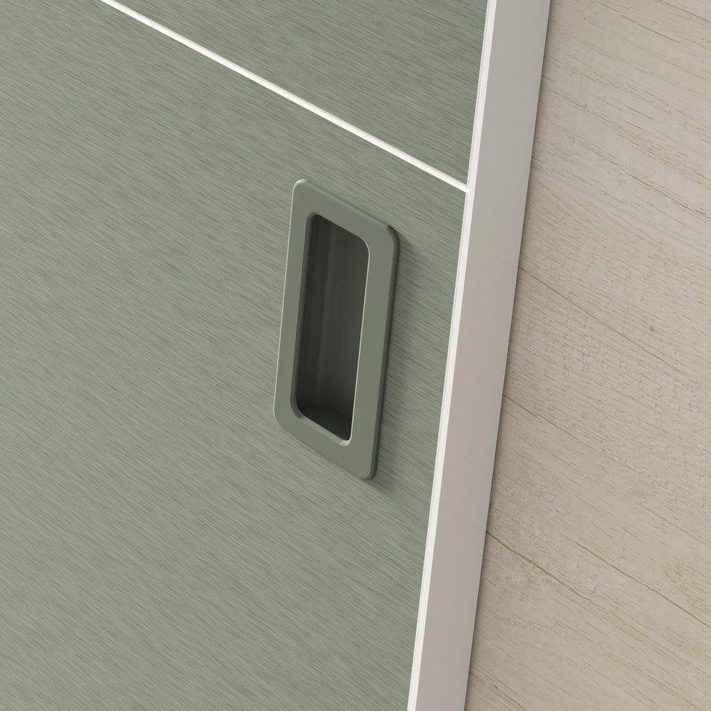 Detalle del tirador concha en las puertas Horizon