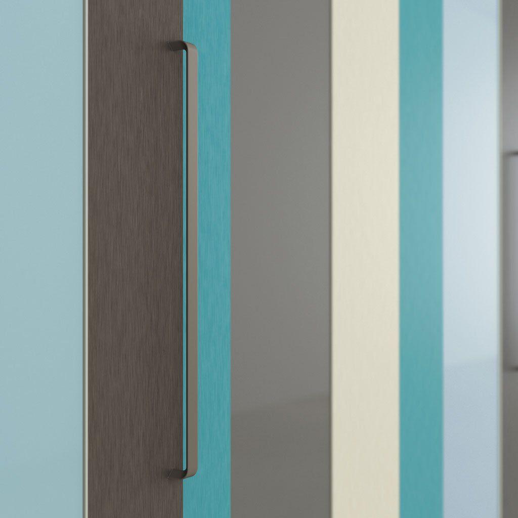 Detalle del tirador Spring en el armario de puertas correderas AV